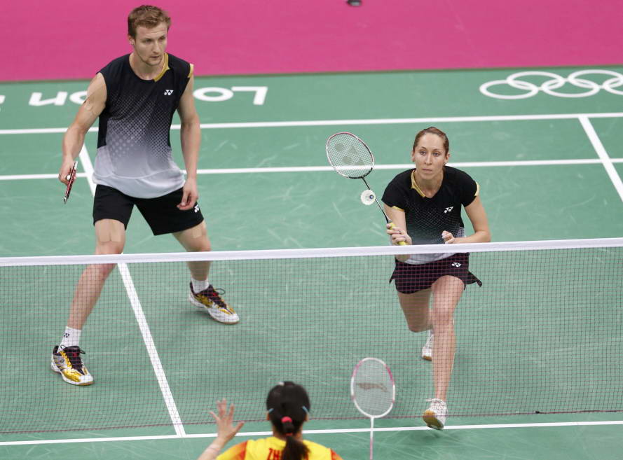 Russia's Alexandr Nikolaenko (L) and Valeria Sorokina play against China's Zhang Nan and Zhao Yunlei during their mixed doubles group play stage badminton match at the Wembley Arena during the London 2012 Olympic Games